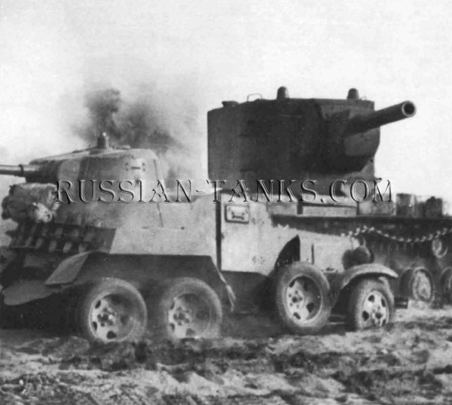 Heavy Tanks: The huge turret of a KV-2 looms over a BA-10 armoured car during fighting in 1941