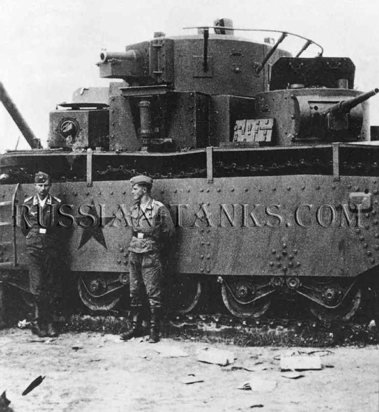 Heavy Tanks: Two Luftwaffe NCOs are dwarfed by a T-35 knocked out early in Operation Barbarossa