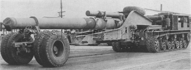 The heavy tractor T22 is towing a 240mm howitzer tube.