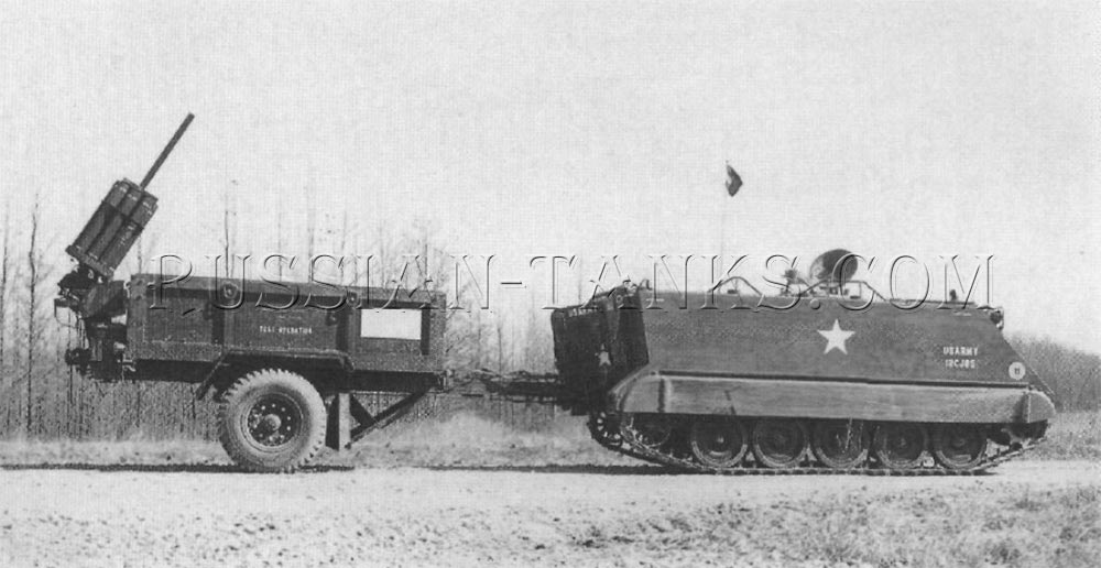 The Giant Viper mine clearing system is being towed in its trailer by an armored personnel carrier