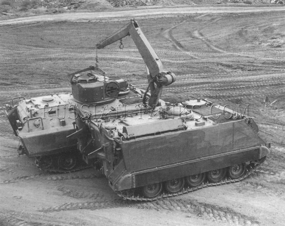 The maintenance and recovery vehicle lifting the turret off of an armored infantry fighting vehicle