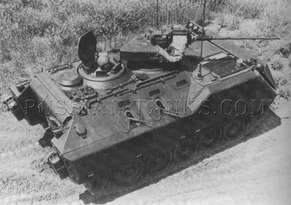 The product improved M113A1 with two firing ports per side and the 20mm gun on the weapon station
