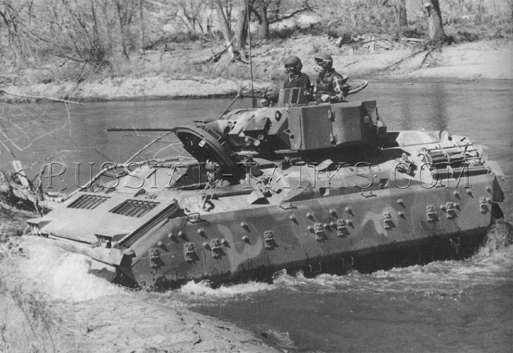 The Bradley is fording in shallow water