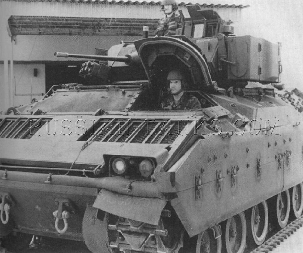 The M3A1 cavalry fighting vehicle is shown with the hatches open and the missile launcher retracted into the travel position